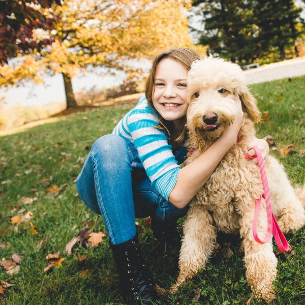 girl hugging hypoallergenic dog
