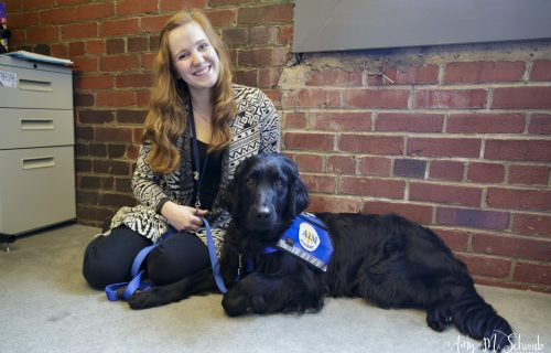 young women handler with facility dog at aim academy